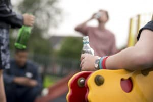 teenagers drinking in the park