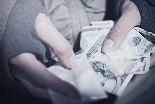 Fentanyl and money in hand