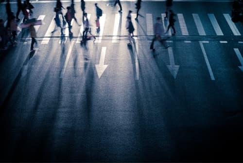 dark busy city crosswalk
