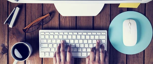 person typing on computer