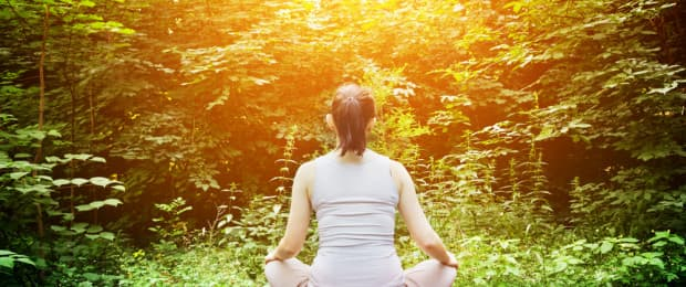 woman meditating for addiction treatment